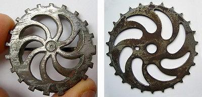 ancient-3rd-roman-cog-wheel-gear.jpg