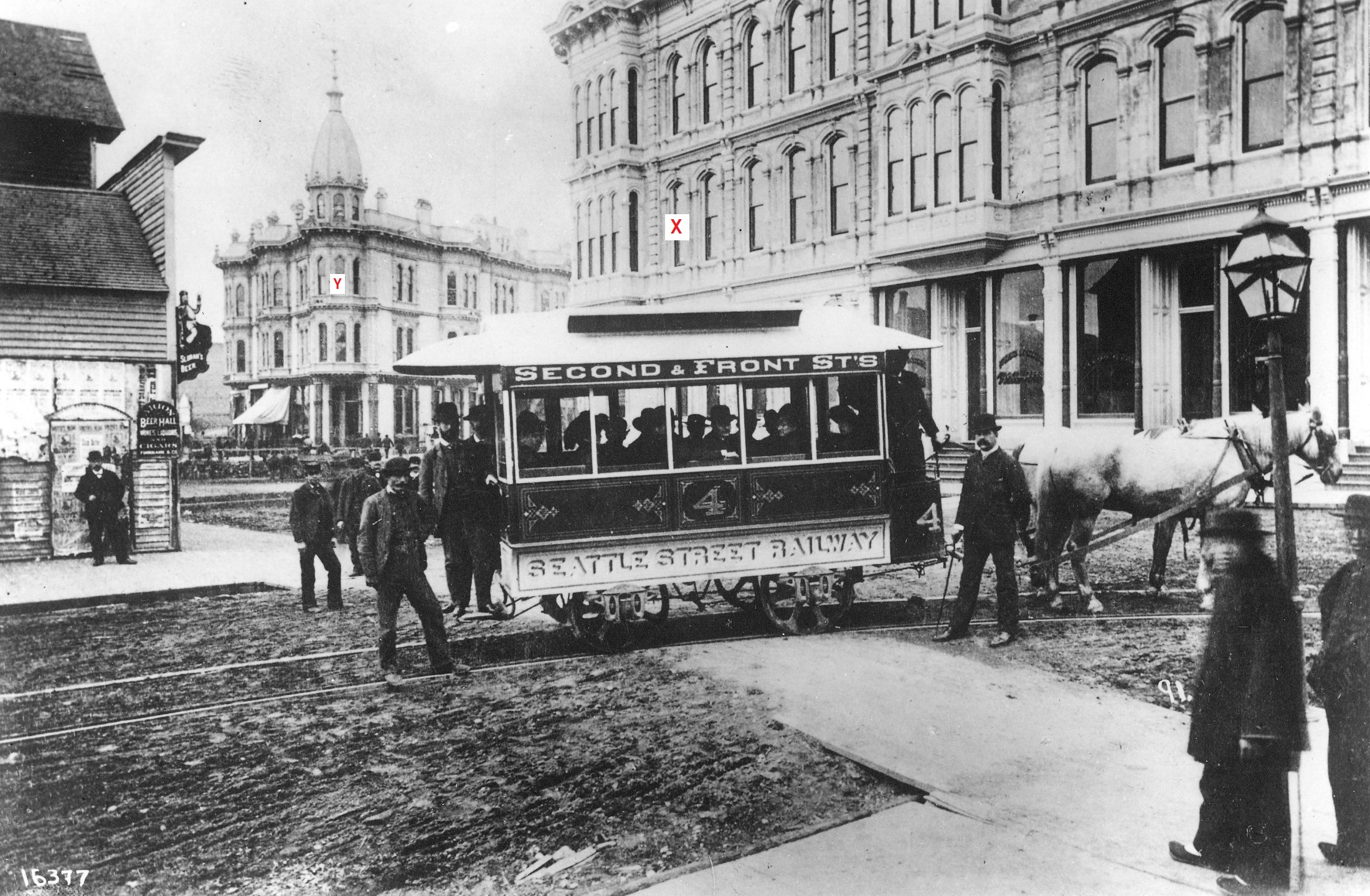 Seattle_Street_Railway,_the_first_streetcar_in_Seattle,_at_Occidental_Ave_and_Yesler_Way.jpeg